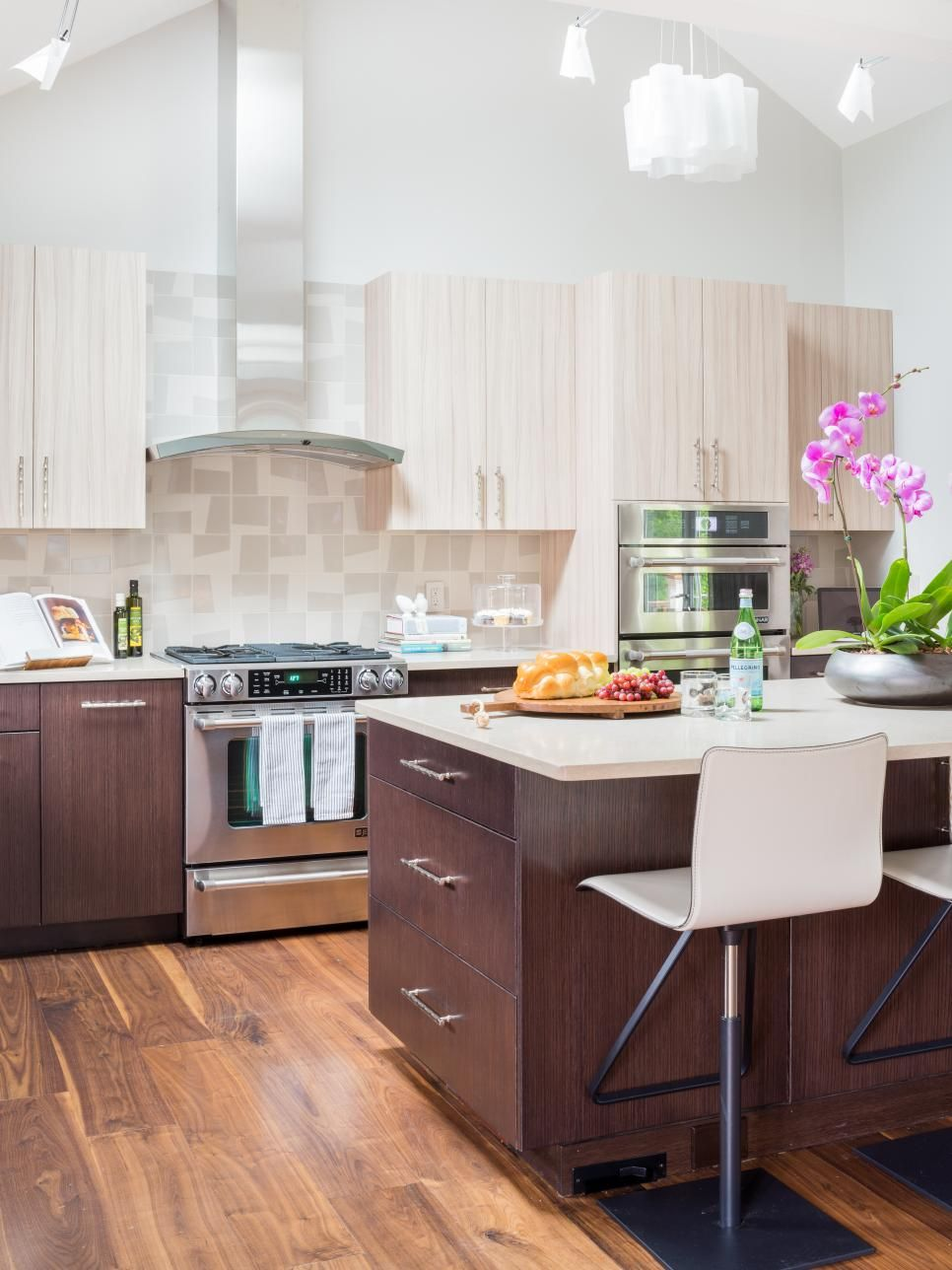 This midcentury modern kitchen features a large island ...