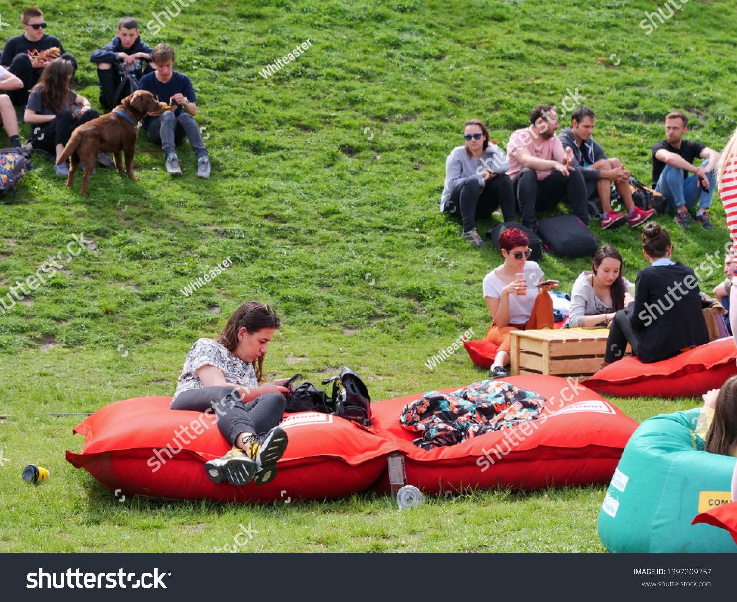 People Relax On Red Inflatable Mattresses Placed On The Green Grass At The Street Food Festival In Cluj Napoca Romania On May 12 2019 Food Festival Festival