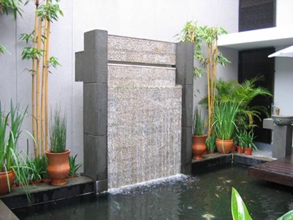 indoor pond and small waterfall - love the pond and the terracota ...