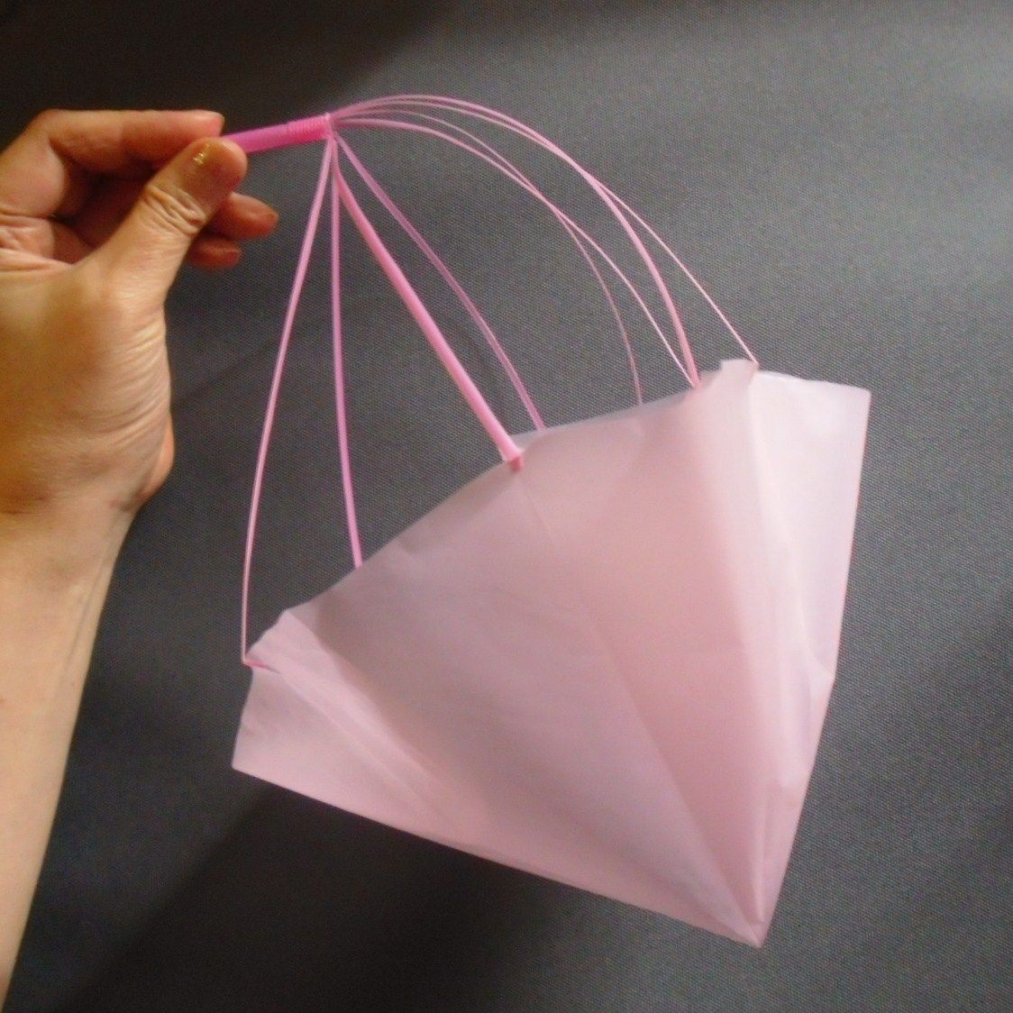 Make a parachute with a plastic bag and a straw for Plastic project ideas