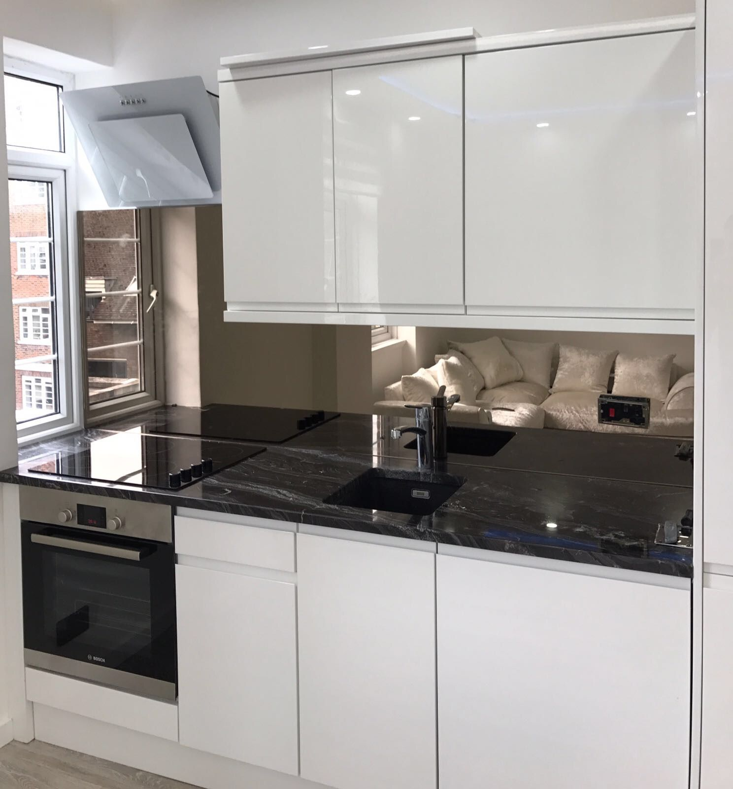 Bespoke bronze mirror splashback supplied and fitted by London Glass ...
