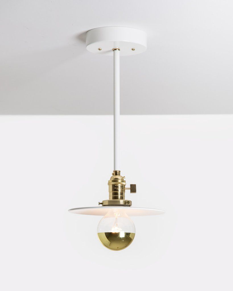 Drop pendant hangs a petite steel disk from a brass fixture with on off switch and a 15 inch white steel rod its available with or without a flush mount