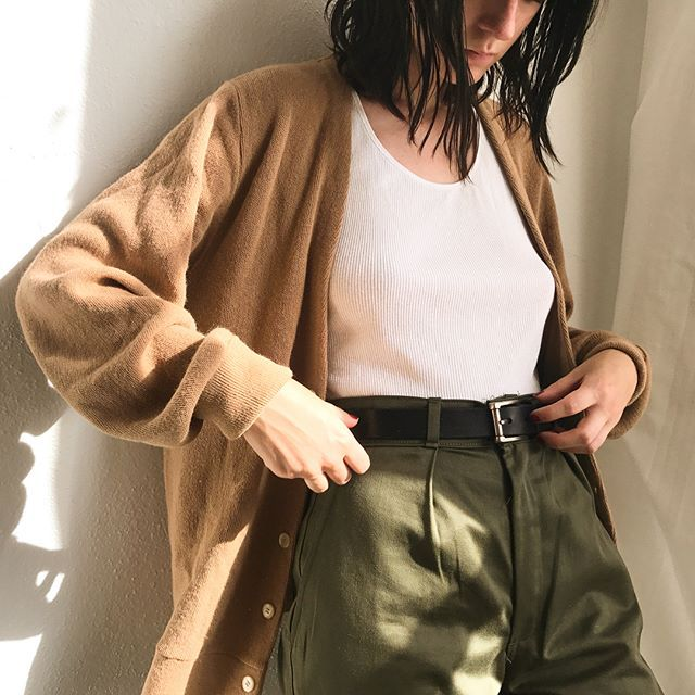 """Warm neutrals. Super cool sand Christian Dior lightweight button up sweater. Sz Sm/M and $46 + shipping. Worn with deep olive Parisian military work pants. 27"""" waist, shown on a Sz 0 and $62 + shipping. First to comment with postal code for purchase. Invoice must be paid within the hour. SWEATER SOLD"""