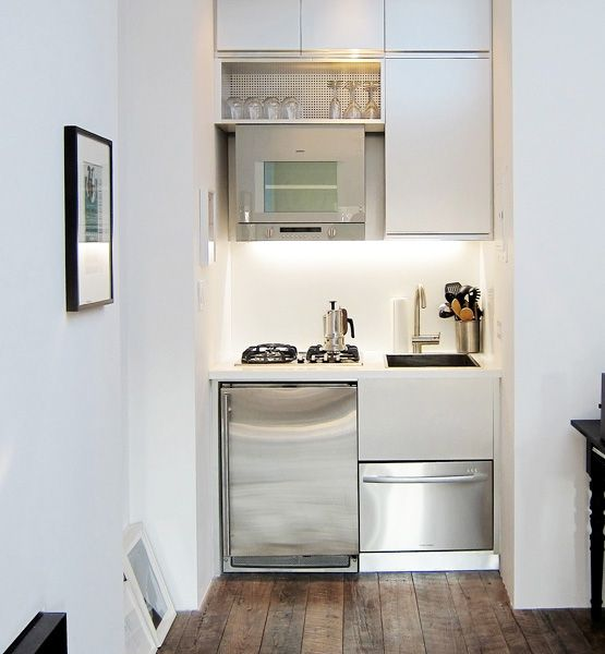 A Tiny Kitchen By Mesh Architectures Occupies A Nook In A 300 Square Foot Art Dealer Studio The Sleek White C Kitchen Design Small Tiny Kitchen Studio Kitchen