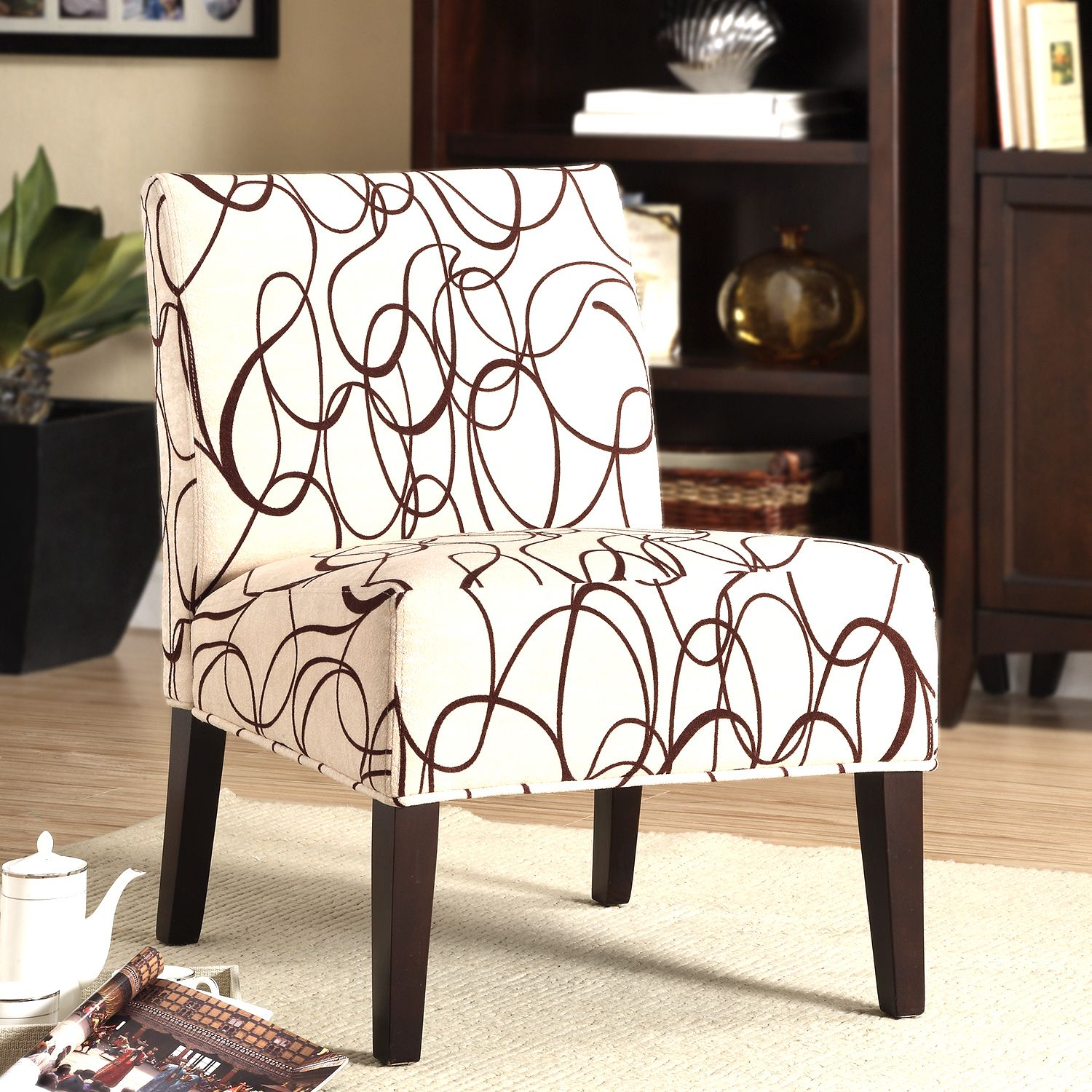 This white-and-brown lounge chair features a modern scroll motif that adds an atmosphere of sophistication to any room in your home. On top of its stylish look, its fabric material and foam filling offer maximum comfort for your relaxation enjoyment.