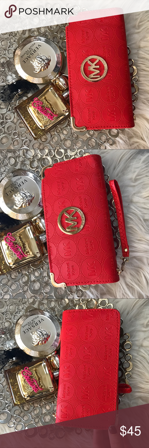 Michael Kors Scarlet red monogram leather wallet Very cute, a lot of space to hold all that you need. Michael Kors Bags Wallets