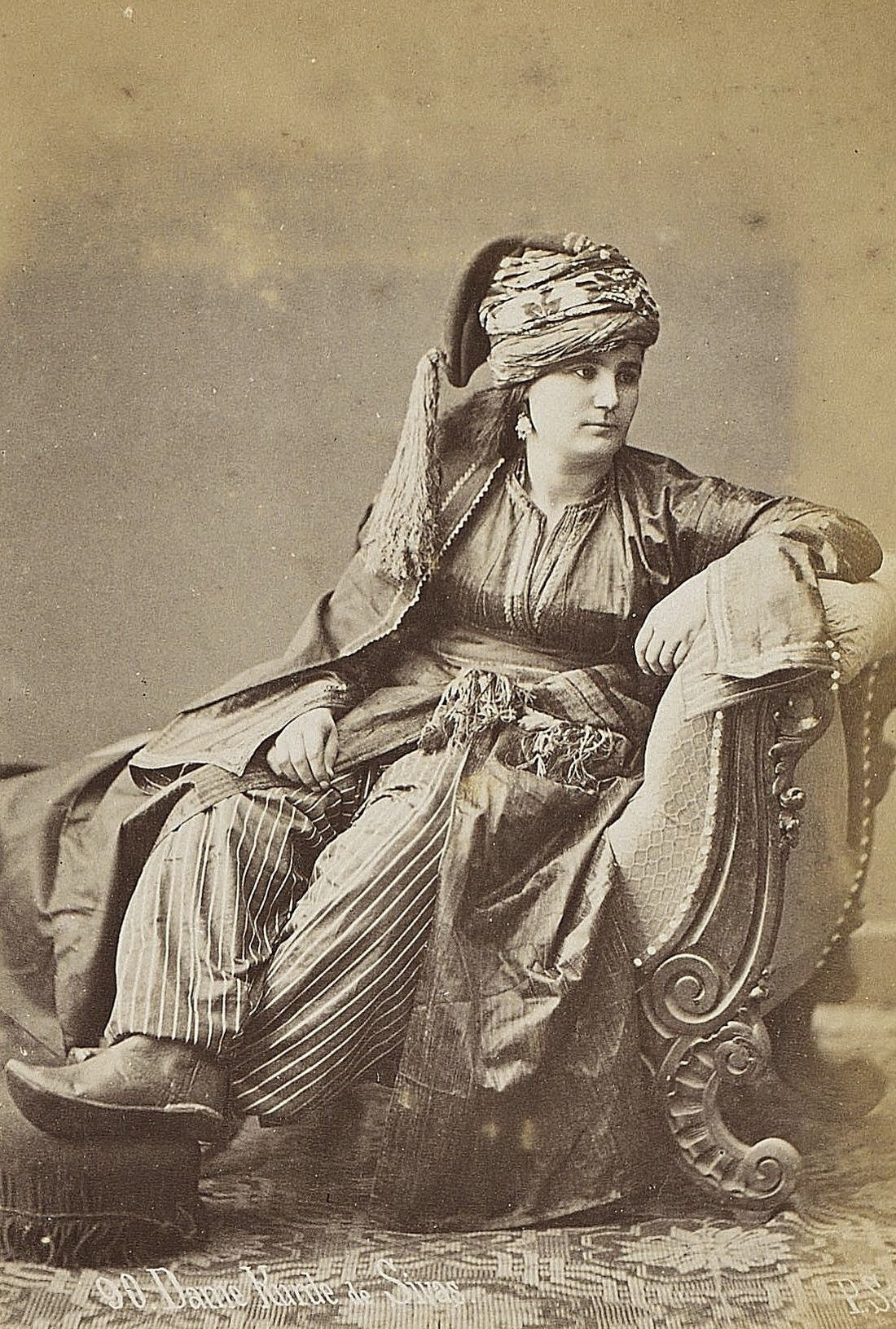 Portrait of a Kurdish lady from Sivas, in festive costume, ca. 1875.   Clothing style: traditional, urban, well-to-do.  Photographer: Sebah Pascal.