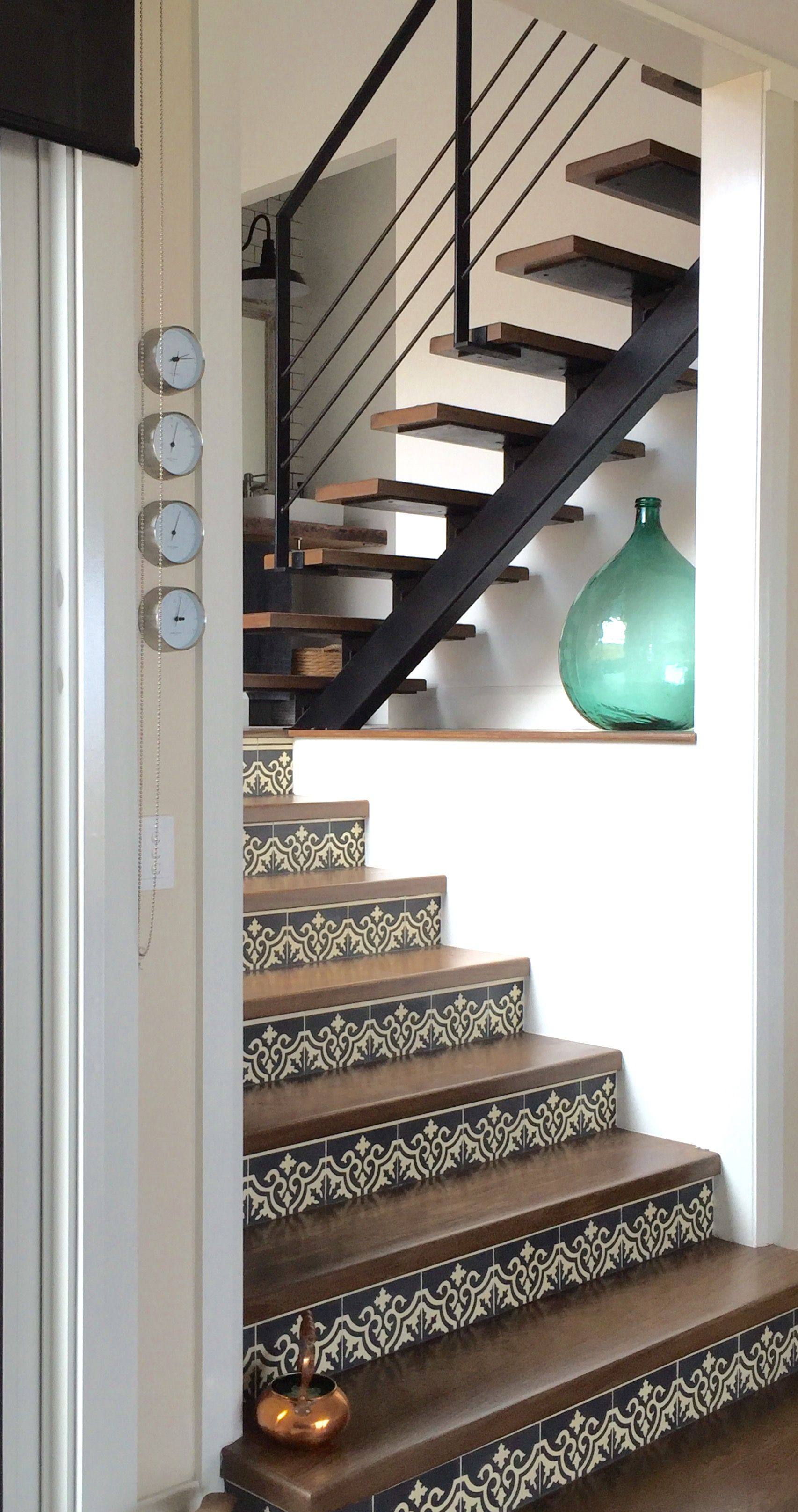 Gorgeous use of Spanish Encaustic Tiles with American Oak stair treads.
