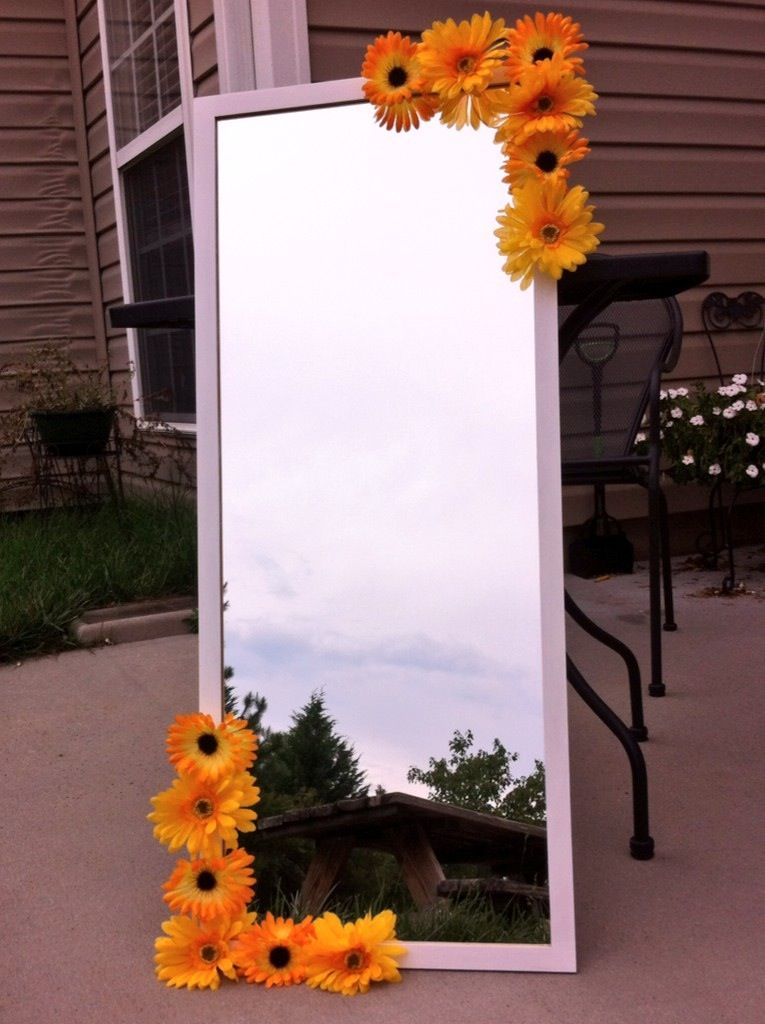 DIY full-length mirror from IKEA with white acrylic paint, hot glue, and fake flowers #sunflowerbedroomideas