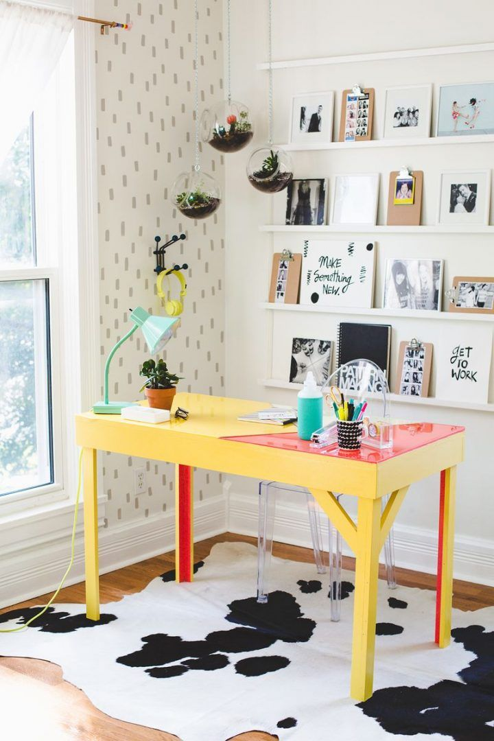 This swoon-worthy home office is on the top of our list for design inspiration thanks to the balance of vibrant color and modern decor. With hanging plants, this creative space has a fresh feeling to it as well!
