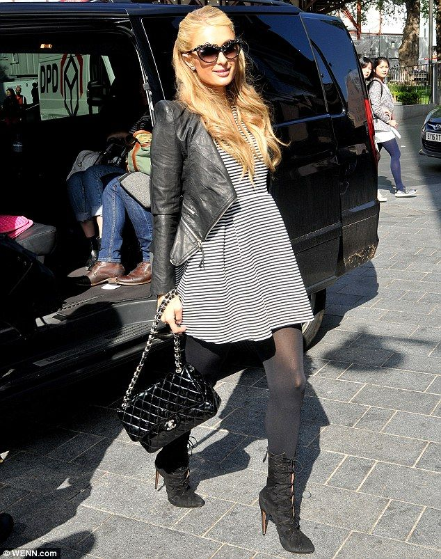 Busy bee: Paris Hilton, 34, was out and about, bright and early on Friday morning promoting her new fragrance in London