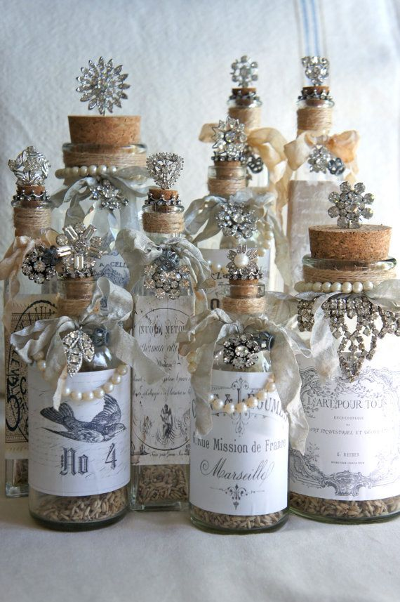 decorated glass bottles. Decorative bottle with french label vintage jewelry accents repurposed  decor decorated by My