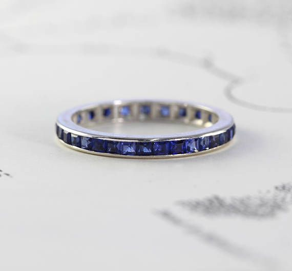 A Lovely Vintage Eternity Band Circa 1930 Crafted In 14k White Gold And Channel Set All Around With Glittering Synthetic Blue Shires