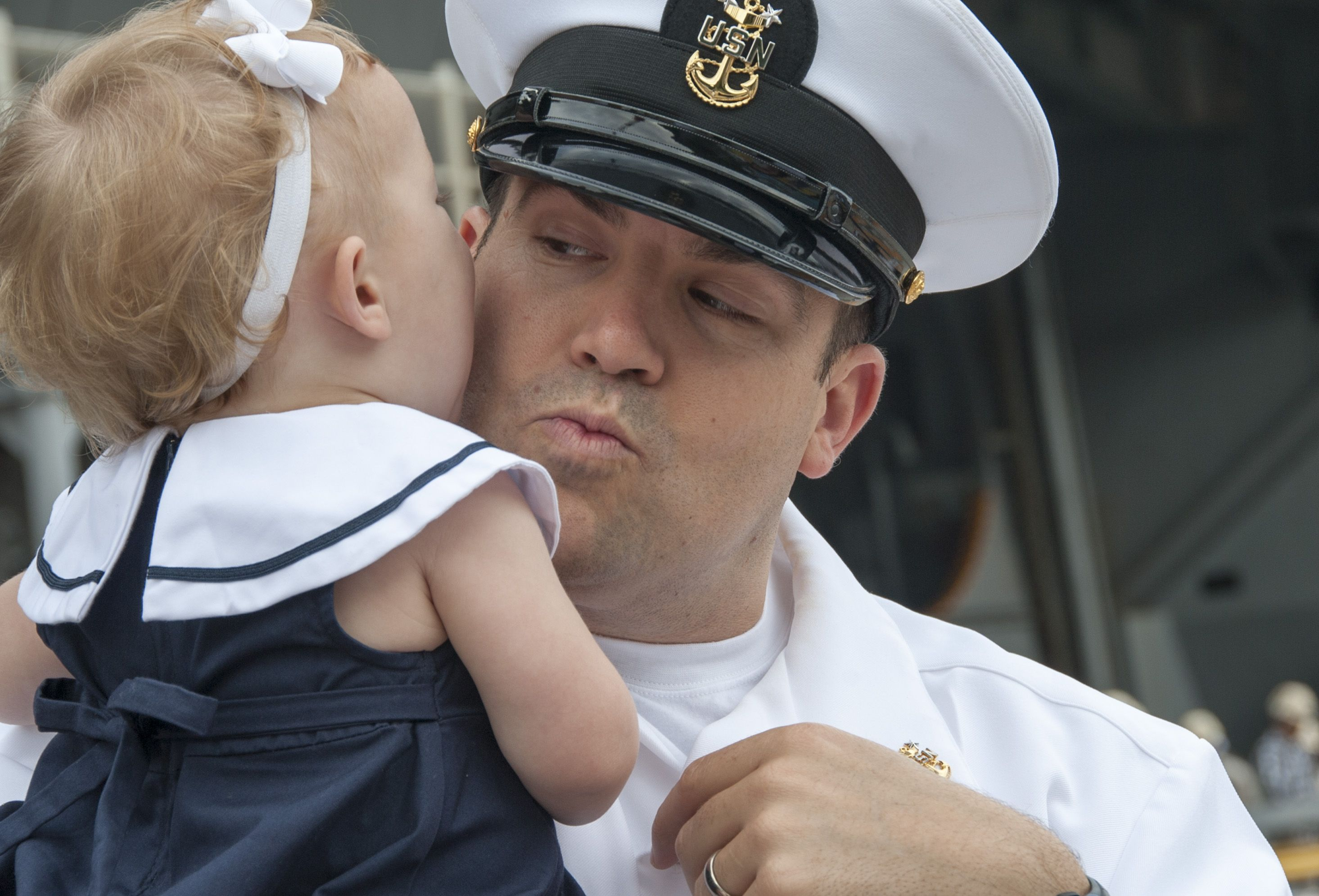 YOKOSUKA, Japan (May 18, 2015) Master Chief Electrician's Mate Nathan Miller, virtual interactive training equipment lead instructor aboard the Nimitz-class aircraft carrier USS George Washington (CVN 73), says goodbye to his daughter as the ship prepares to depart Fleet Activities, Yokosuka for its 2015 patrol. George Washington and its embarked air wing, Carrier Air Wing (CVW) 5, provide a combat-ready force that protects and defends the collective maritime interests of the U.S. and its…