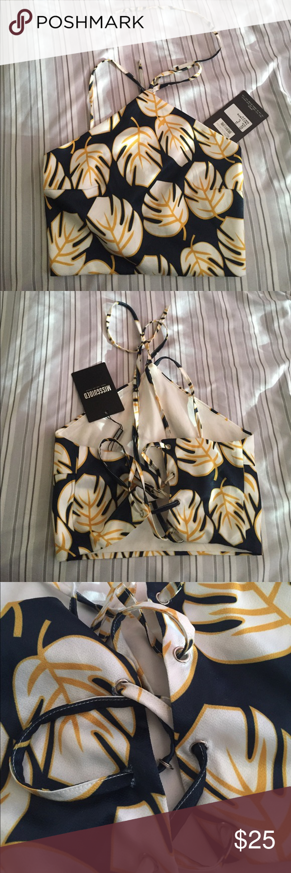 Tropical halter crop top Brand new! Purchased from Nordstrom and didn't notice until now but the 3rd ring is unattached (it's still there and is still functional). Size US 6 but it's adjustable so it can fit various sizes Missguided Tops Crop Tops