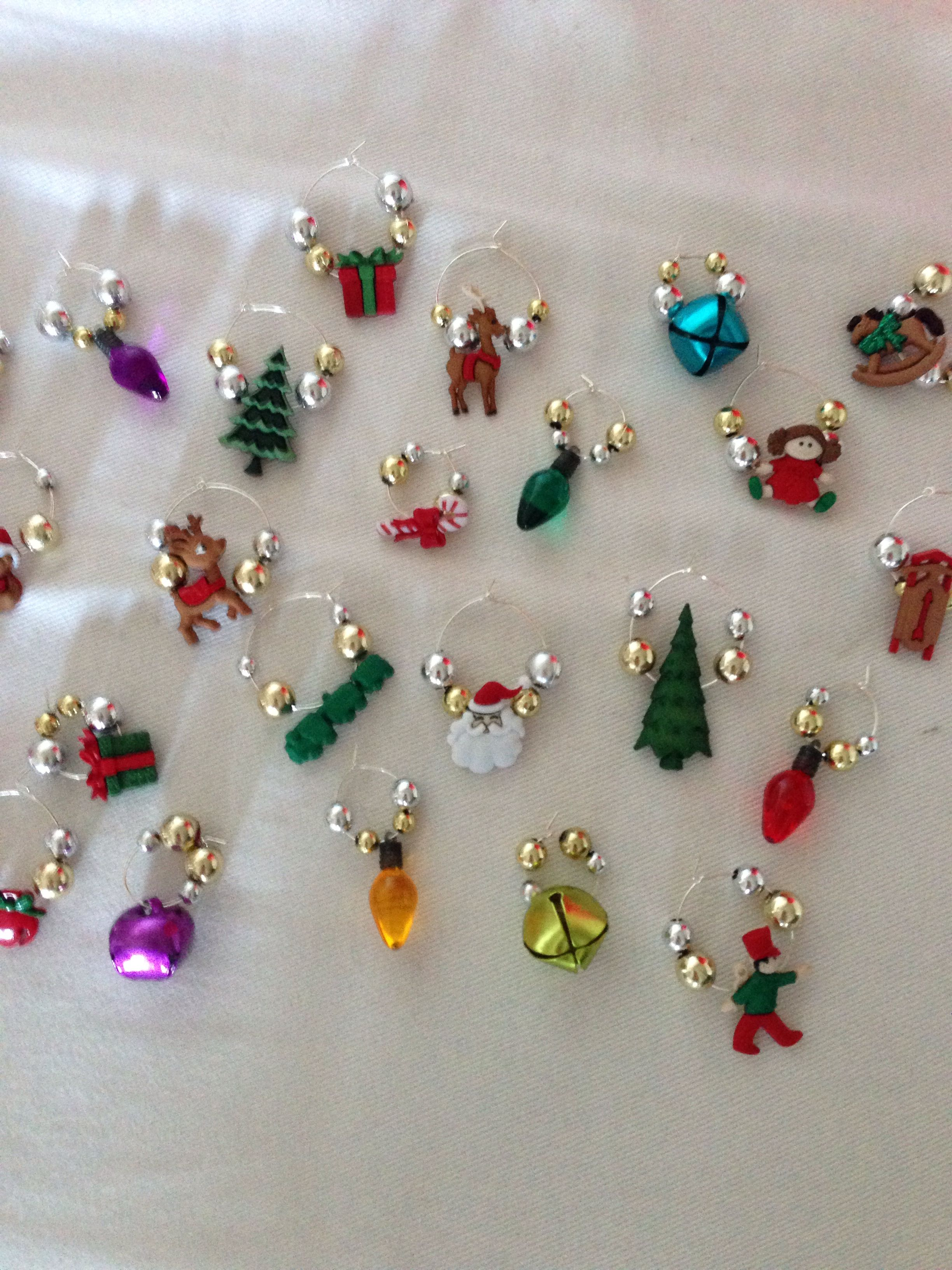 DIY wine charms - Christmas: Hoop earrings from Michaels, beads and trinkets of your choice from Michaels.  That's it!