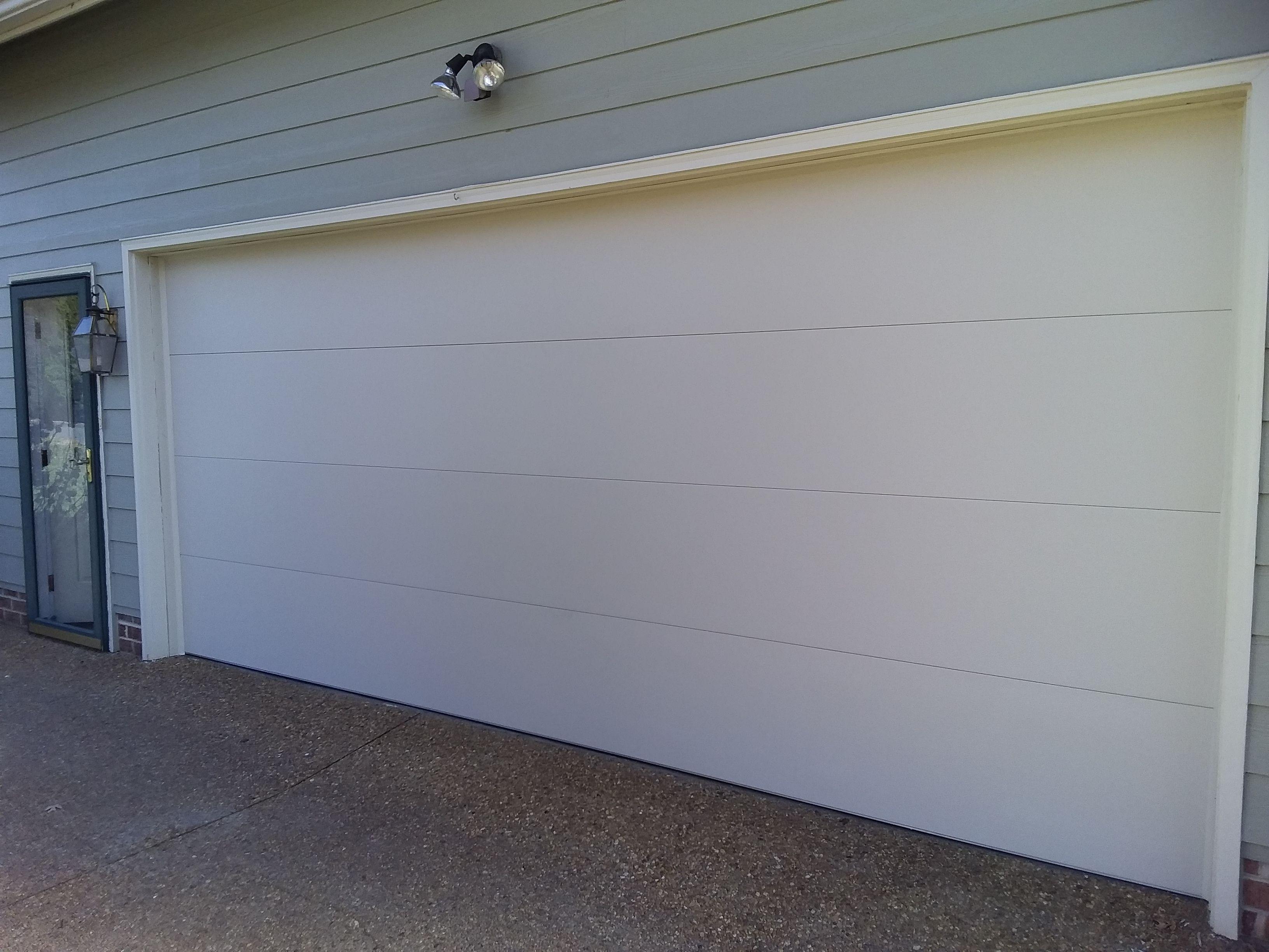 16x7 Model 2217 Flush Almond Garage Door Installed By The Richmond Store Teamappledoor Garage Doors Door Installation Doors