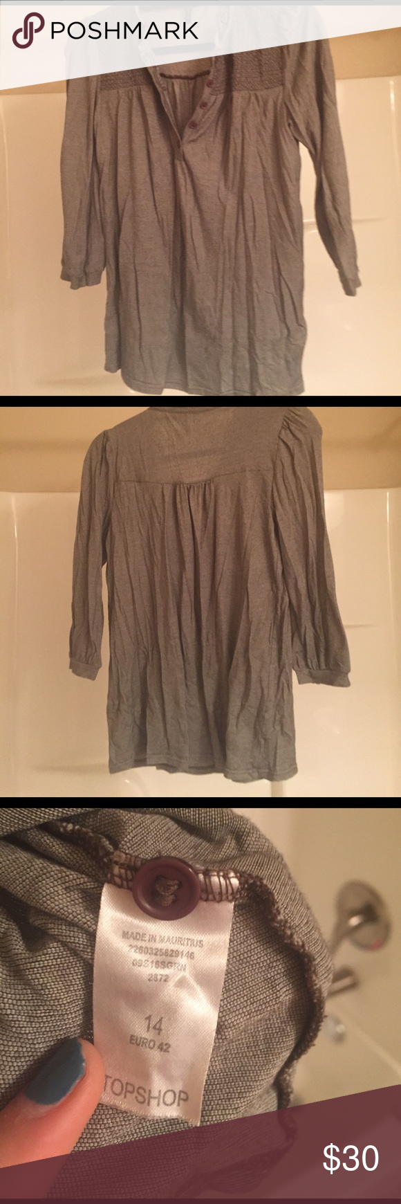 Smocked topshop top Very narrow black and grey stripe, super soft, EUC still has spare button. UK size 14 but looks beautiful on smaller sizes as well (I'm a UK 10) Topshop Tops Blouses