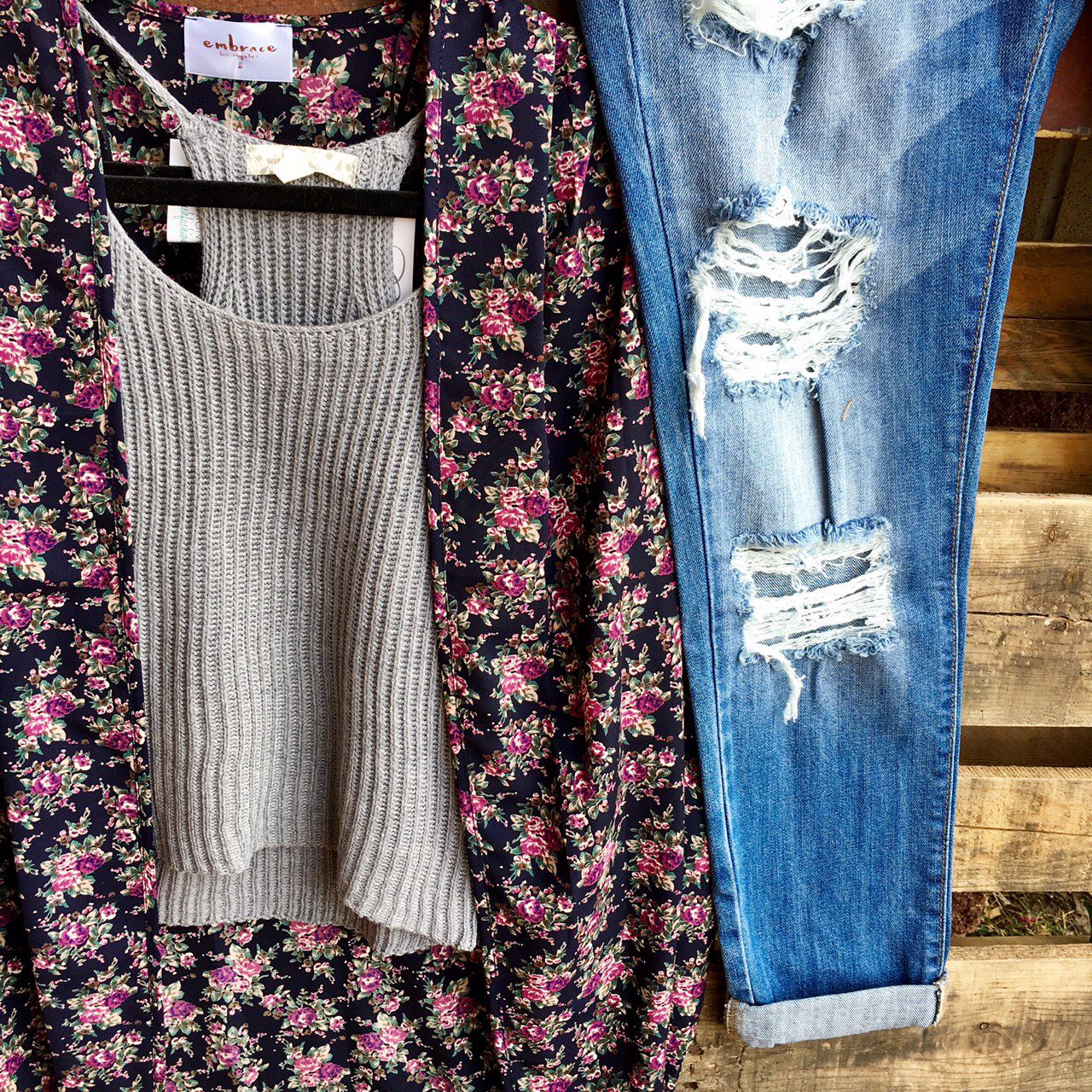 We love this look. Layering a sweater crop top under this floral kimono is perfect for fall transition