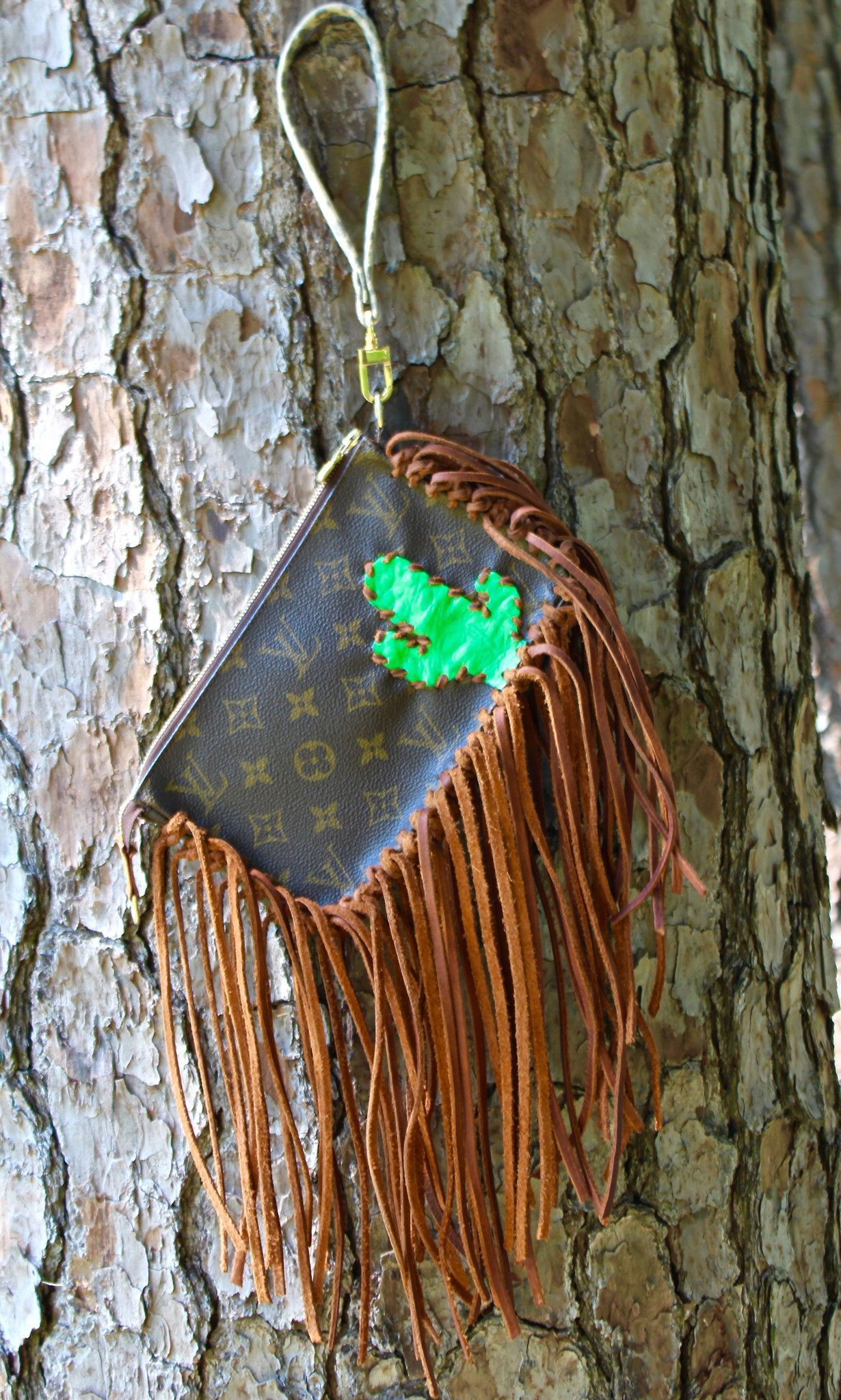 """Authentic Fringe Louis Vuitton Cactus Wristlet by Rockin MD! Ready to ship! - letter of authenticity will be provided! Dimensions - 9.1"""" x 5.1"""" x 1.6"""" Please email info@toosassyboutique.com for additi"""