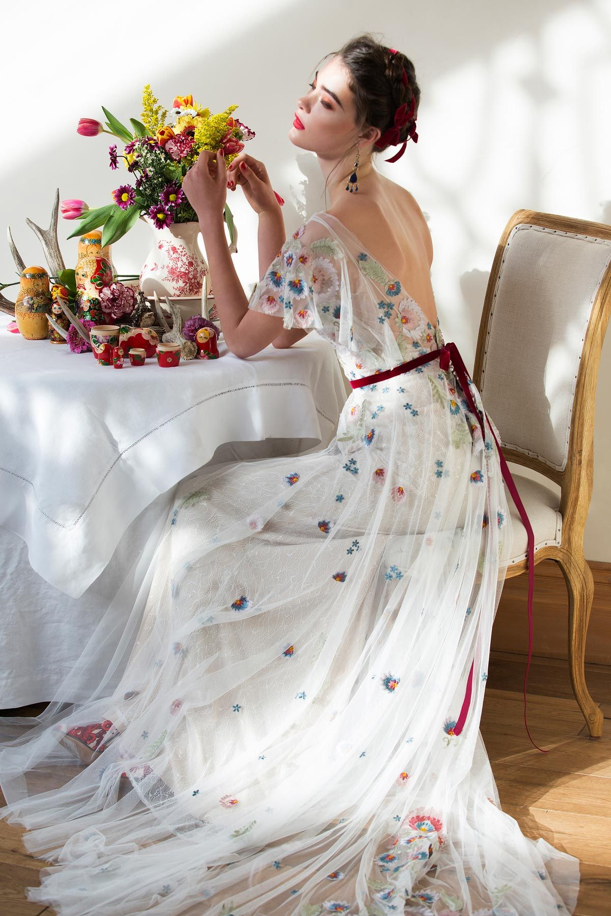 16caae2c91e This gorgeous bridal gown inspired by modern folklore is crafted from  Tillie Chantilly on soft netting. It features an illusion neckline