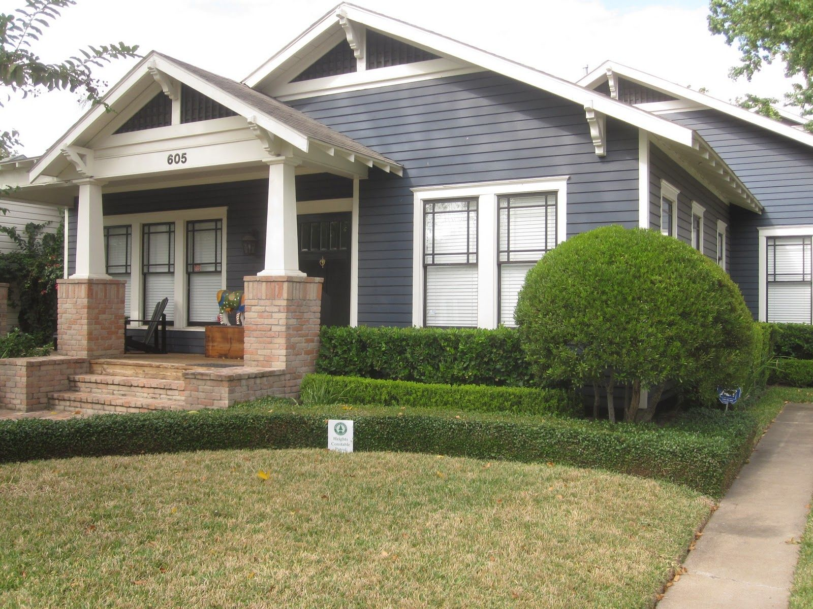 Bungalow Exterior Paint Color Schemes  Immaculately kept bungalow of bluegray with white trim