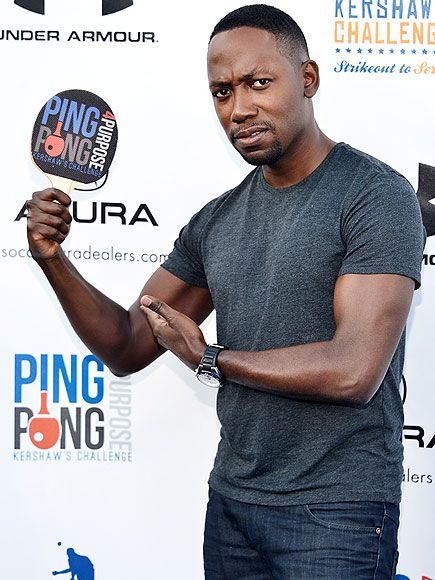 That's using his muscle! New Girl's Lamorne Morris shows off his biceps at the Ping Pong 4 Purpose charity event benefiting Kershaw's Challenge at Dodger Stadium Thursday in L.A.