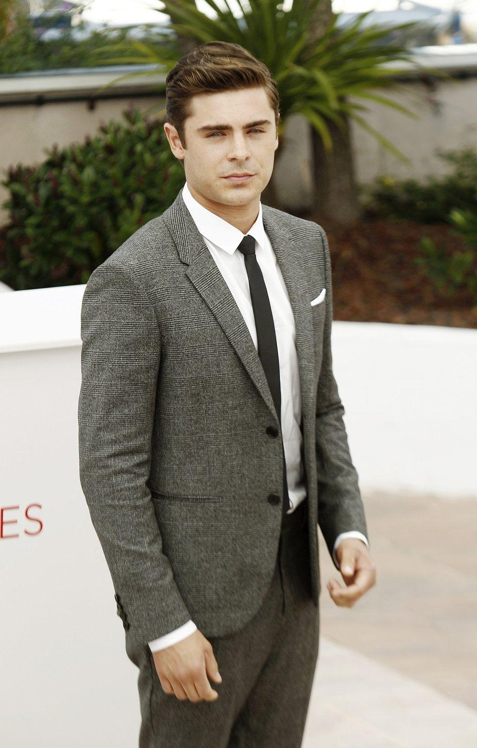 Zac Efron gray suit red carpet white shirt black tie | Suits