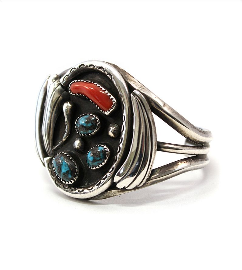 Silver Navajo bracelet with coral and turquoise stones.