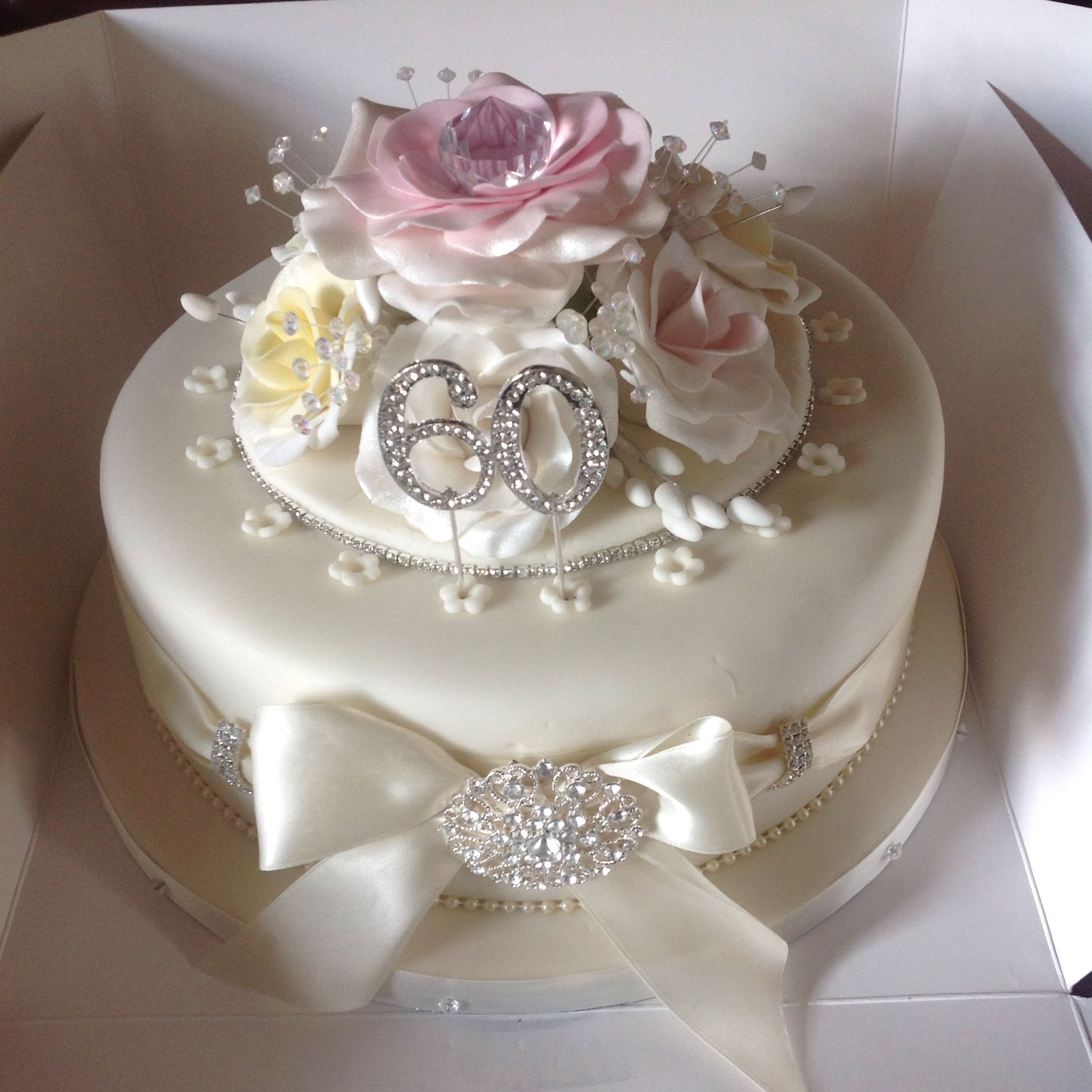 Diamond wedding anniversary cake, pastel coloured flowers