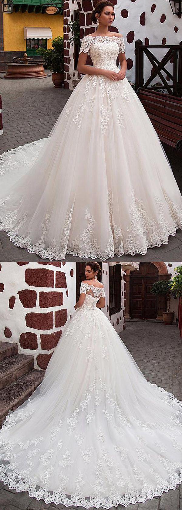 Attractive tulle offtheshoulder neckline ball gown wedding dress