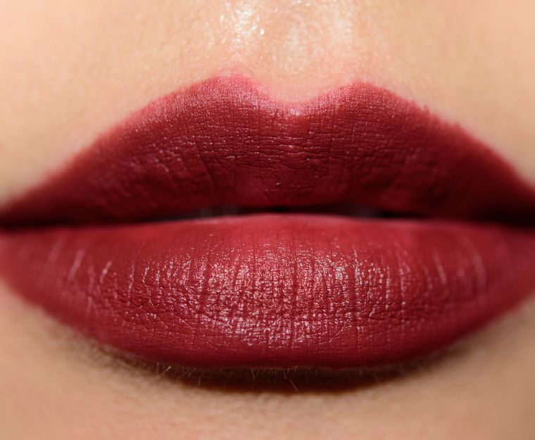 "MAC Bowl Me Over Lipstick is described as a ""deep burnt brown [with a Retro Matte finish]."