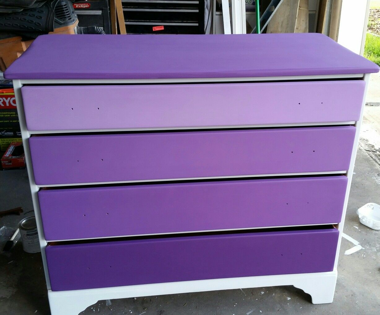 The white and purple dresser without the handles put back on art