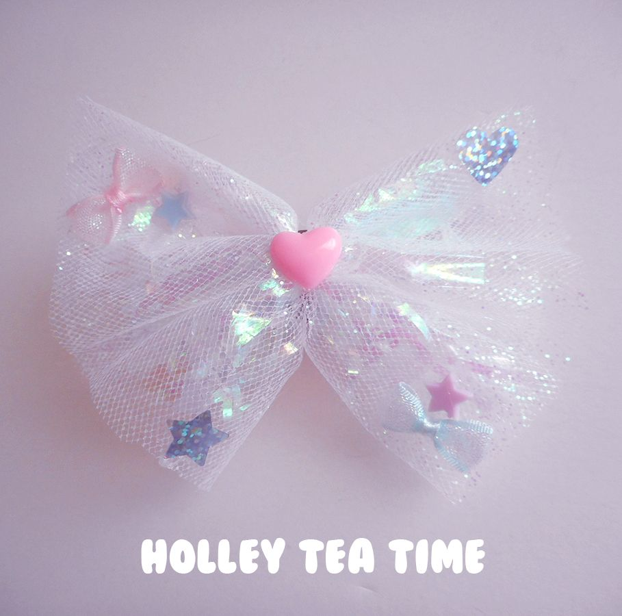 """☆ A holographic iridescent dream*¨*•.¸¸⋆*✩ ☆ cute hair bow and pin ☆ made from magical glitter tulle ,holographic film / cellophane, iridescent bows and stars ☆ size: 12 cm x 9 cm (4.7"""" x 3.5"""") ☆ iridescent fairy bows and plastic heart ☆ Brooch & Clip on back ☆ to pin on clothing and..."""