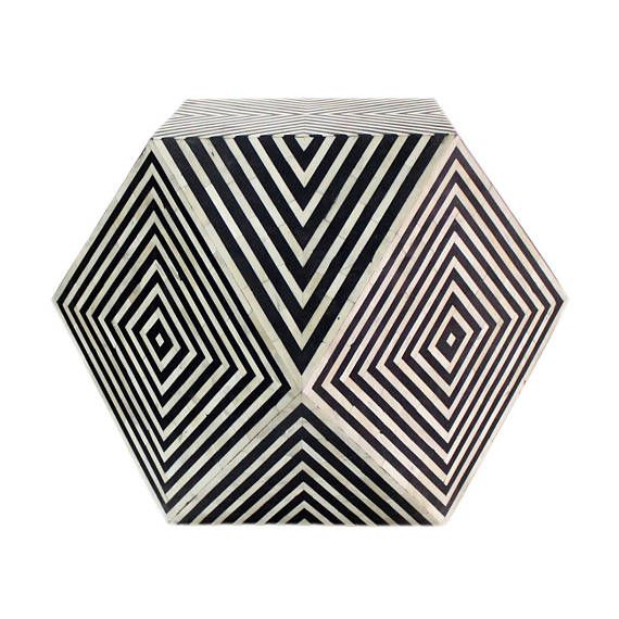 This hypnotically designed piece is a unique addition to our inlay furniture collections. Handmade in India, skilled artisans inlay bone into a resin frame to produce this work of art. To achieve this unique shape and design on this striped Inlay Side Table, our artisans hand cut solid