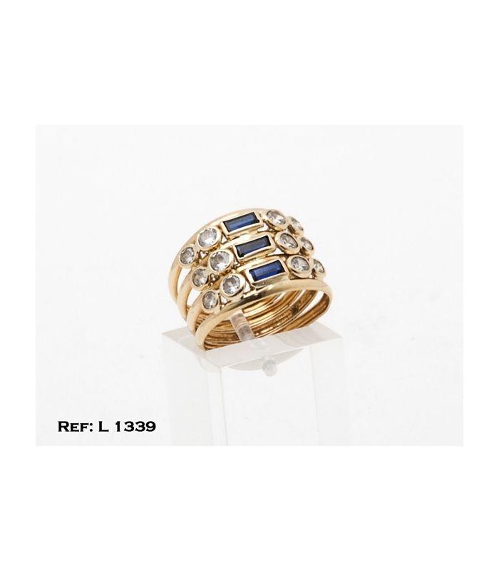 01572d267275 Anillo Oro 18kt cuatro aros unidos por tres piedras azules