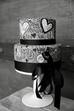 Black and White urban wedding cake with graffiti and black ribbon.