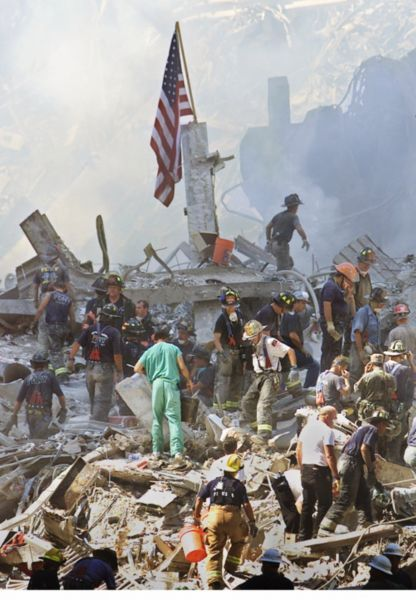 9/11, September 11, 2001, Terrorist Attacks, Twin Towers, World Trade Center, NY, US. Never forget. Rescuers searching the rubbles for survivors. History, photo. The day the world changed.