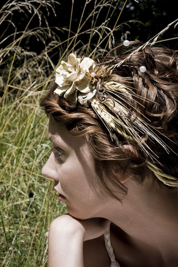 Natural details including wheat, star anise, seed pods and willow branches complete this vine crown. Adjustable in the back with white or ivory ribbons.