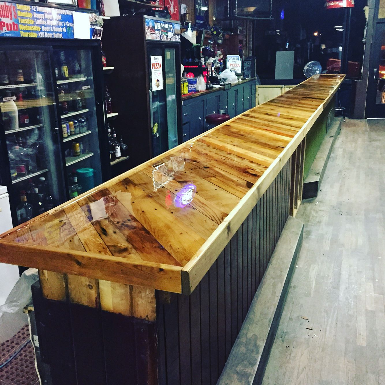 Bar top made from pallet boards and covered with epoxy for Wooden bar design