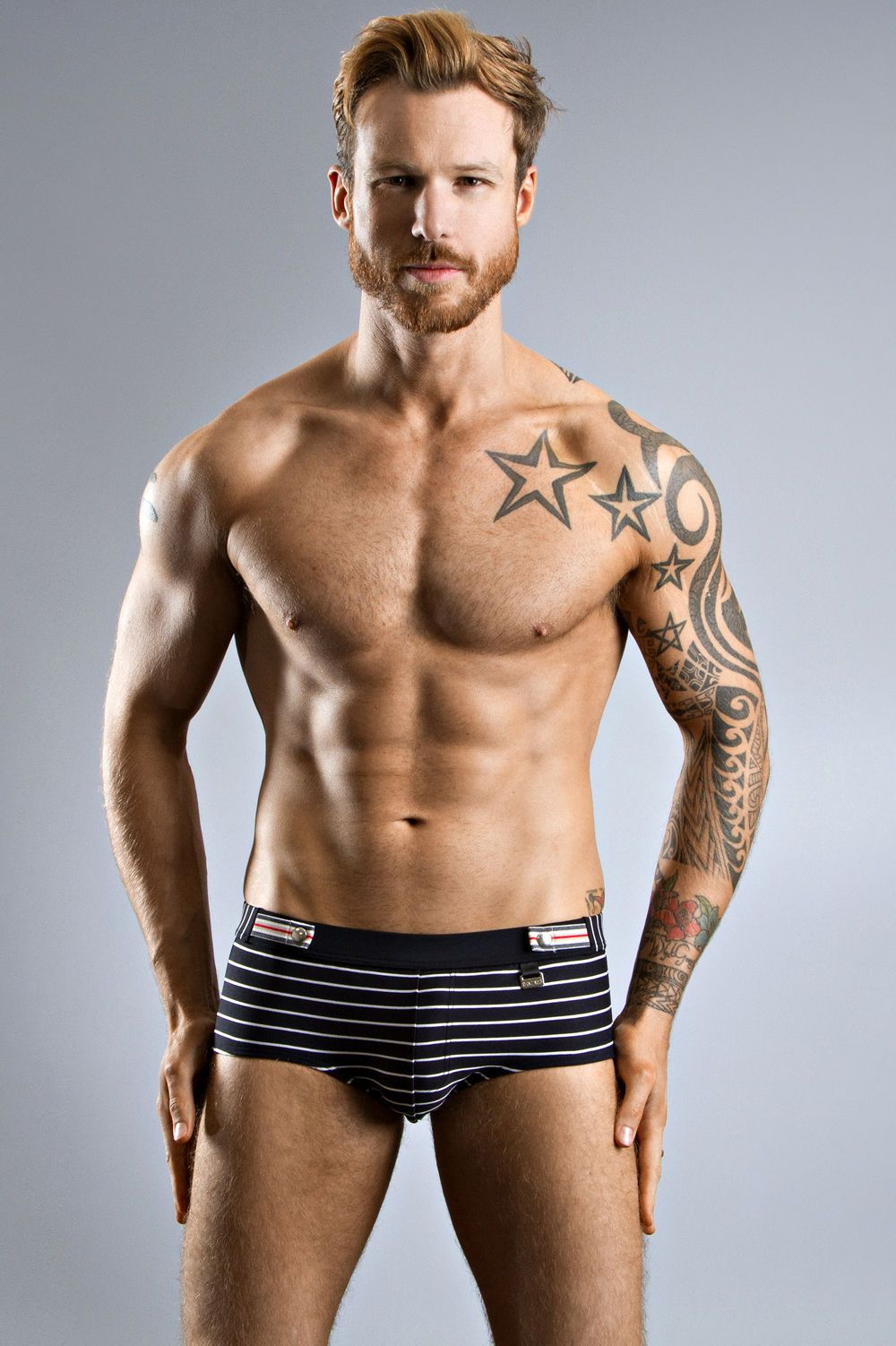 daba170e41f585 The horizontal stripes across this vintage swimwear for men will look  amazing on the beach this