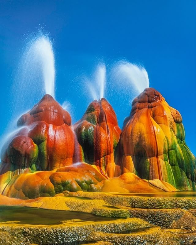 Photo by @FransLanting This may look like a vision of an alien planet, but it actually is a natural scene from Nevada's Great Basin. Primitive bacteria stain the sides of a geyser with fantastic colors while hot water erupts from deep underground. Some scientists believe that this is the kind of extreme environment where life may have begun on earth billions of years ago. For more marvels from our living planet follow me @FransLanting.  @natgeotravel @natgeocreative @thephotosociety #Geyser…
