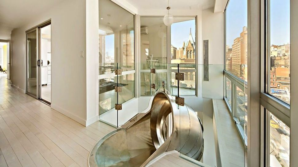 These Houses Have Indoor Slides Two penthouses connected with a slide is a really cool thing, but the pro poker player Phil Galfond used this for only four years. It was sold last year for $3.3 million.