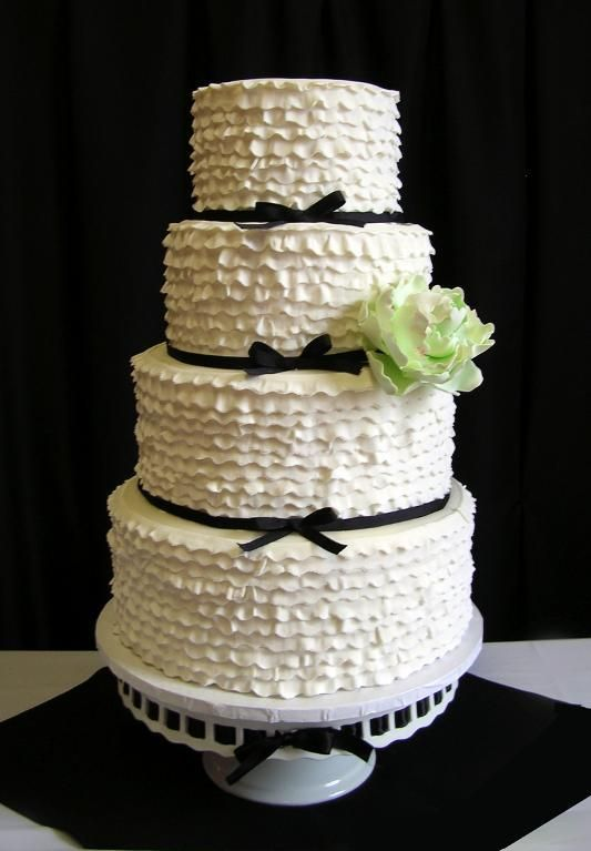 Take a look at this gorgeous ruffled wedding cake by Craftsy member HeavenlyCakes! The ruffles are made from a mix of fondant and gumpaste - so clever! Click the image for a closer look at this fantastic cake and click the heart to let the decorator know you love it! #cakedecorating