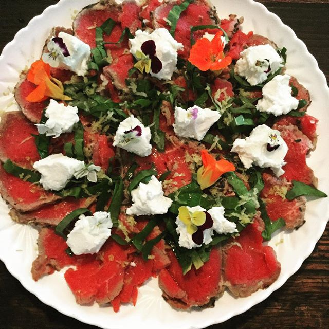 A perfect day for a beef  carpaccio rolled in homegrown herbs with lemon juice and zest topped with sorrel @meredithdairy goats cheese and edible flowers. X #daisydining #daylesford #catering #daylesfordcatering #bespokecatering #bespoke #traditionalcooking #localproduce #carpaccio #beef #goatscheese #herbs #food #foodpics #foodstyle #foodgram #foodshare #foodforfoodies #privatechef #privatedining #events #melbourne #melbournefood #weekend #weekendgetaway #wanderlust #wandervictoria…