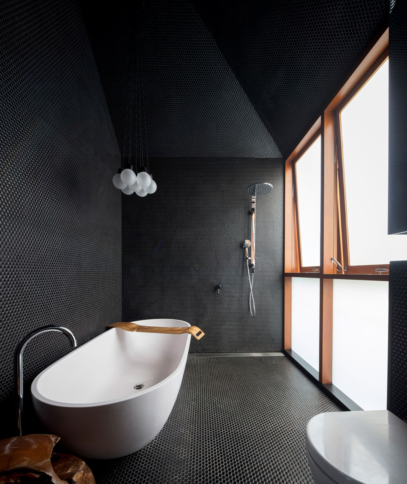 Black Bubbled Walls Feature In The Bathroom Which Has An Asymmetric