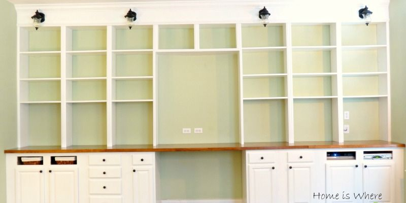Learn how to build a wall-to-wall built-in desk and bookcase unit. Starting with thrifted cabinets makes this project great even for beginning DIYers!
