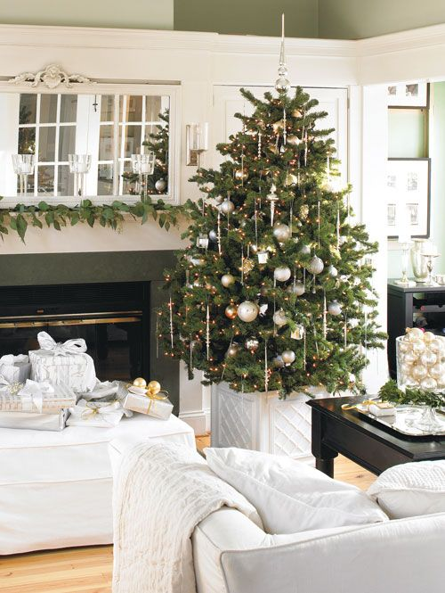 holiday decor - love simplicity I like how they put the tree in a