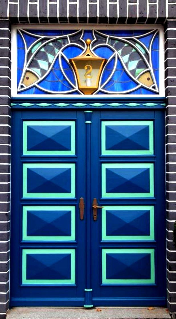 Pretty blue fish doors in Lüneburg, Lower Saxony, Germany.