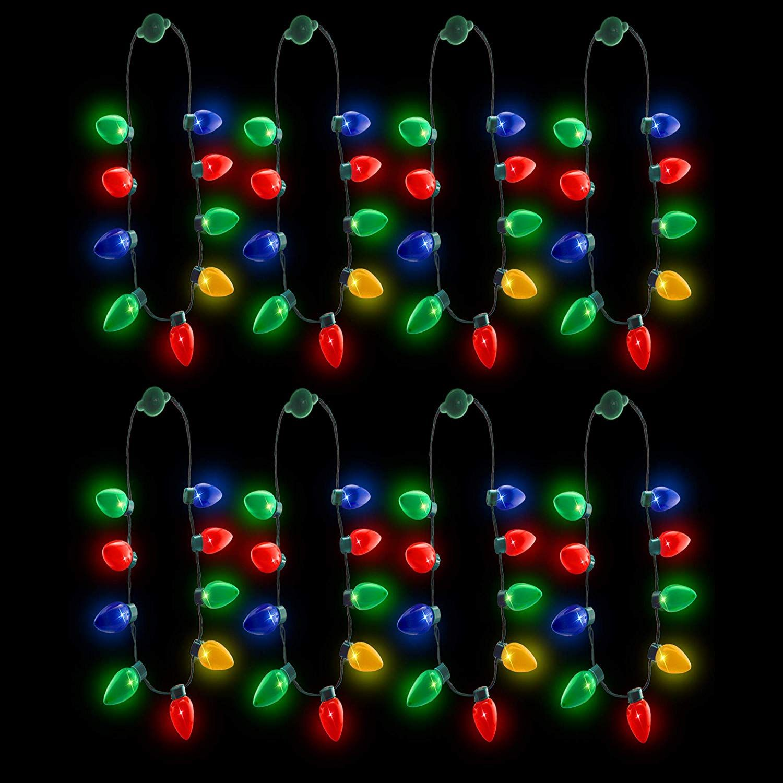 Amazon Com Windy City Novelties Led Light Up Christmas Bulb Necklace Party Favors Family 4 Pack Toys Game Christmas Bulbs Windy City Novelties Led Lights